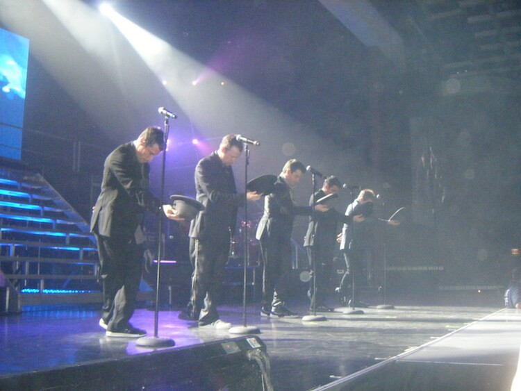 New Kids on the block on stage in suits with hats in hand   Eat Sleep Breathe Music