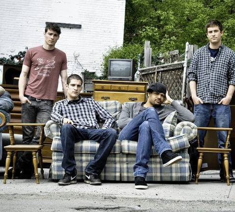Safe to Say Band Photo two guys sitting on a couch and two standing next to it   Eat Sleep Breathe Music