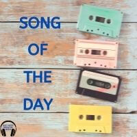 """Four colored tapes on a wood table with the words """"Song of the Day"""" 