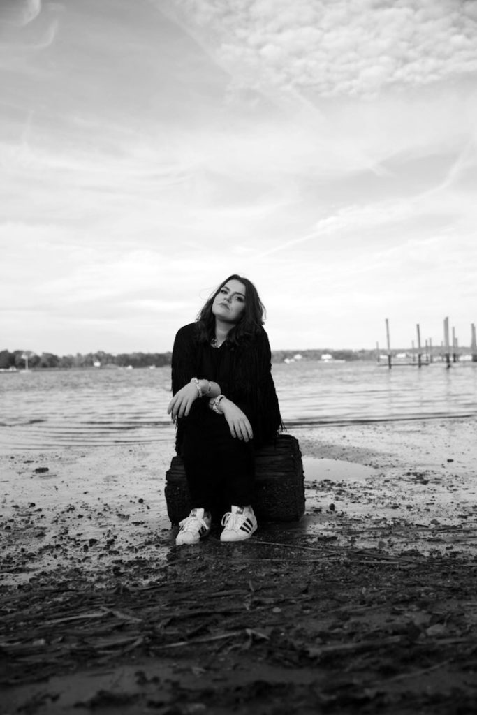 Carvi Sitting on a Rock in the Water | Eat Sleep Breathe Music