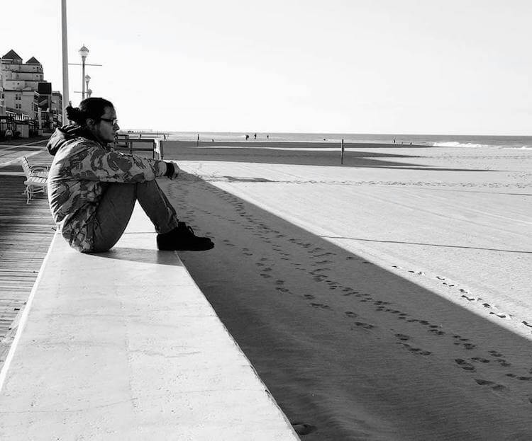 Michael Sky Sitting by the beach in black and white photo Song of the Day | Eat Sleep Breathe Music