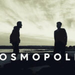 Two men standing on the beach with shadows on their body | Song of the Day Cosmpolis | Eat Sleep Breathe Music