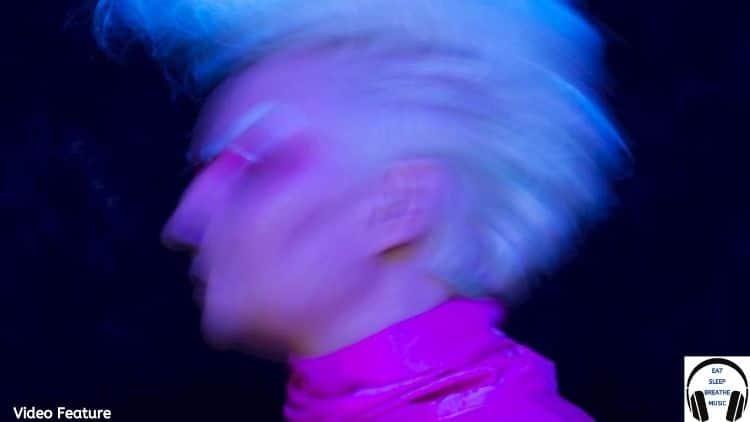 Helinksi Woman GEA with Blond Hair wearing a pink turtleneck | Video Feature | Eat Sleep Breathe Music