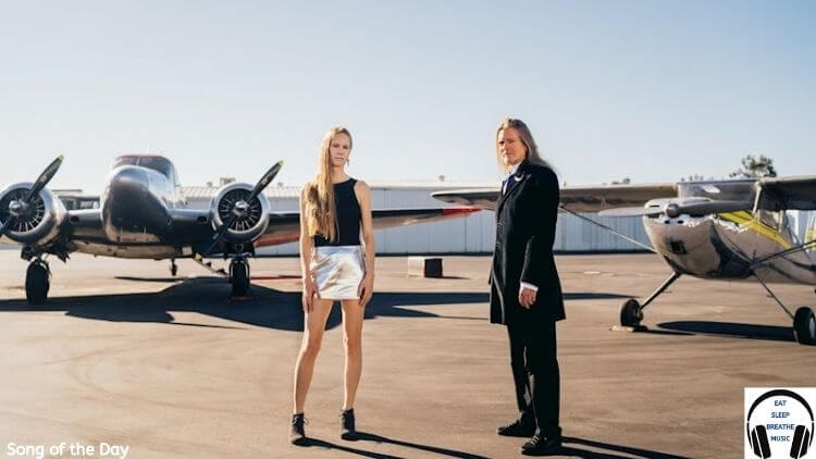 White woman and White man standing on front of private planes |Sluka Tonight You Belong to Me Song of the Day| Eat Sleep Breathe Music