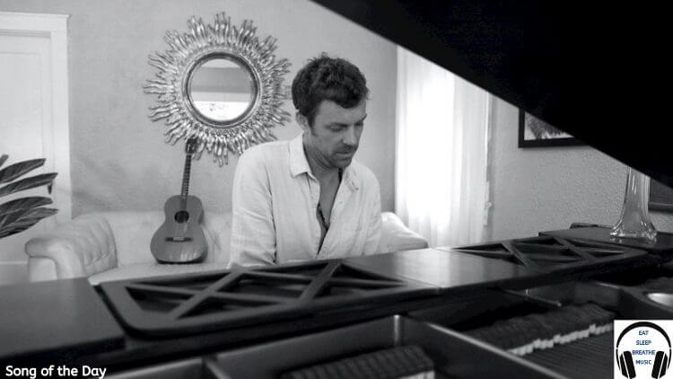 White Man playing a piano in a white shirt black and white photo | jefff Song of the day feature | Eat Sleep Breathe Music