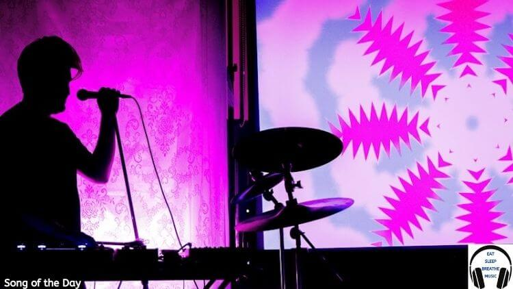 silhouette of a man at a keyboard with a microphone and pink background | Jobbaloon Song of the Day Feature | Eat Sleep Breathe Music